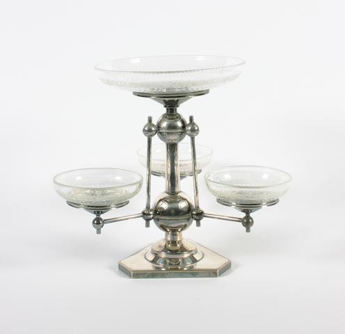 An electroplated and glass mounted table centrepiece, by Hukin & Heath, in the style of Christopher Dresser
