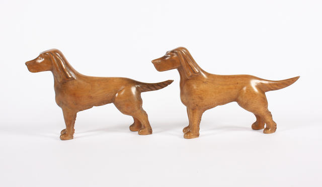 Two carved walnut dogs by Lazlo Hoenig