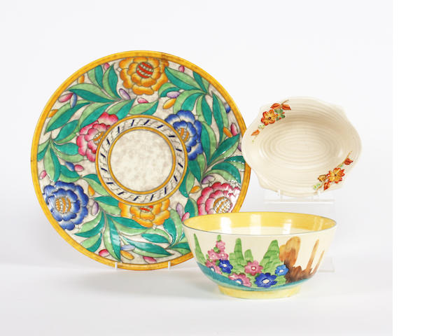 A Clarice Cliff Bizarre 'Fragrance' bowl, a Clarice Cliff Newport pottery dish and a Charlotte Rhead large dish
