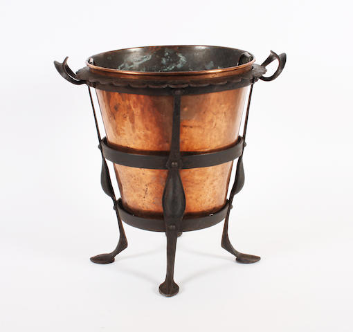 A blackened wrought iron and copper lined fireside bucket in the Birmingham Guild style