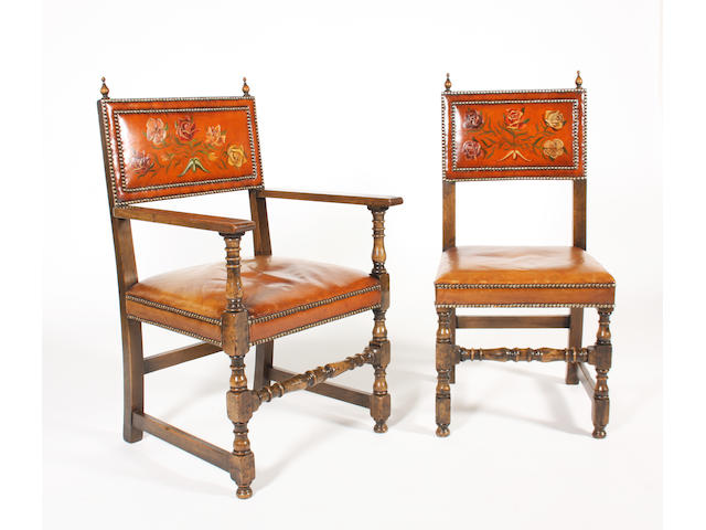 A reproduction set of ten, 17th century style, stained oak and leather  dining chairs, in the Spanish style, by Frederick Tibbenham