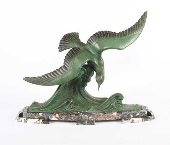 A French Art Deco bronzed base metal model of a sea bird in flight