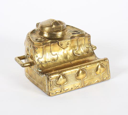 An Art Nouveau brass inkstand