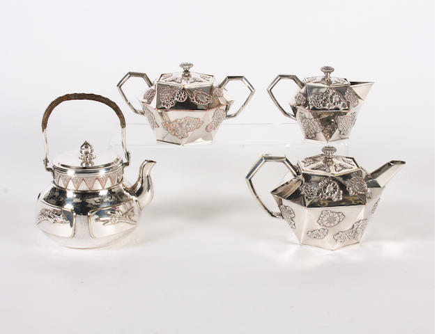 An oriental style electroplated three piece teaset and a similar kettle