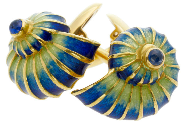 A pair of eighteen karat gold, sapphire and enamel cufflinks