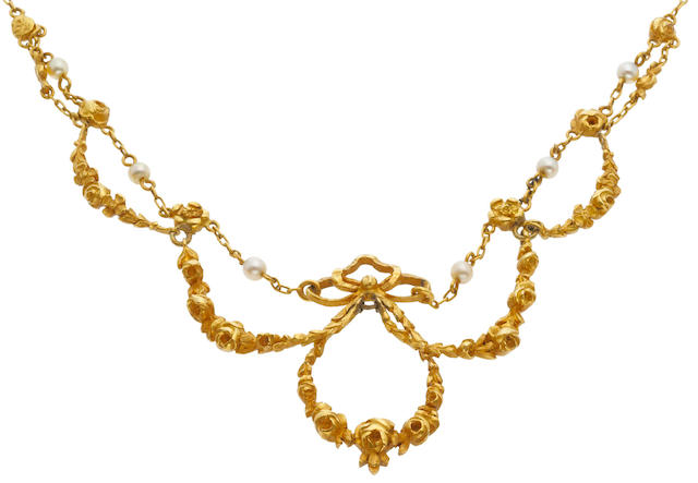 An antique eighteen karat gold and seed pearl necklace,5