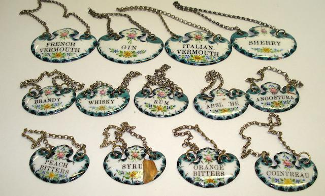 A collection of enamelled decanter labels 19th Century