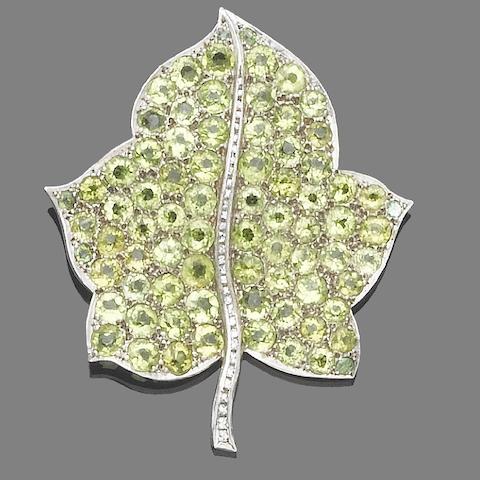 A peridot and diamond leaf brooch