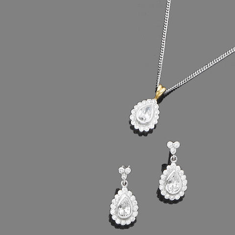 A diamond pendant necklace and earring suite (2)