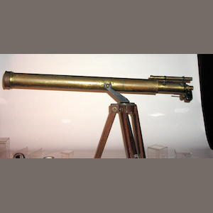 A Clarkson 4 1/2-inch brass refracting astronomical telescope on stand
