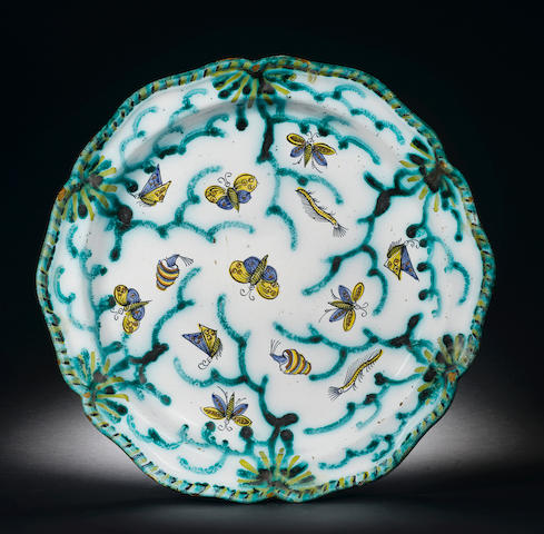 A Brussels faience dish painted with butterflies and caterpillars, circa 1770, 40cm