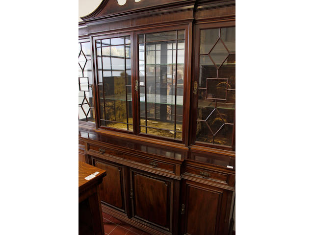 A Edwardian mahogany breakfront display cabinet by Gillows,