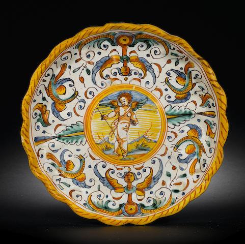 An Italian 17th C Deruta tazza with putto in the cavetto