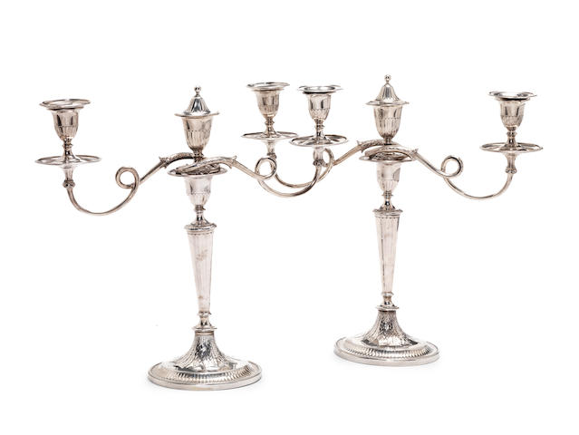 A pair of George III silver three-light candelabra, by Robert Sharp, makers marks illegible on bases, London 1791,