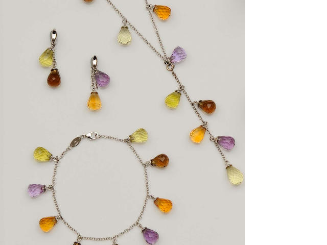 A gem set pendant necklace, bracelet and earring suite