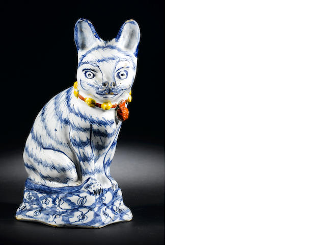 A Dutch Delft model of a cat, circa 1740-50 (old damage to the base and very fine hairline in the body)