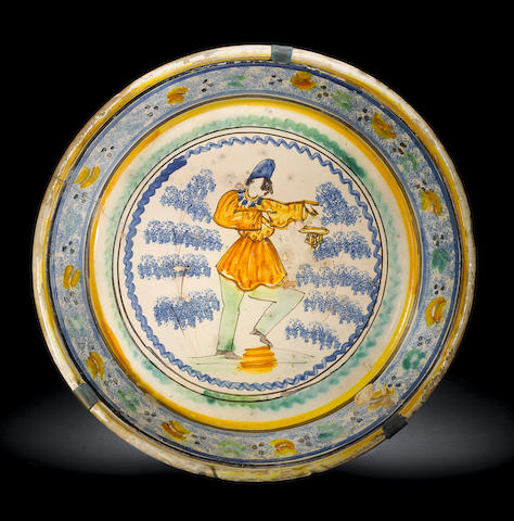 A large Ariano Irpino plate with Pulcinella (cracked)