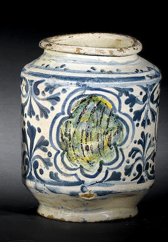 A 17th century tin glaze albarello for honeysuckle