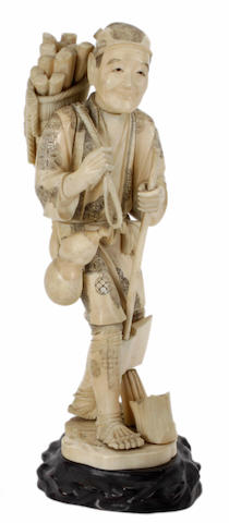 A Japanese ivory large figure of a wood cutter