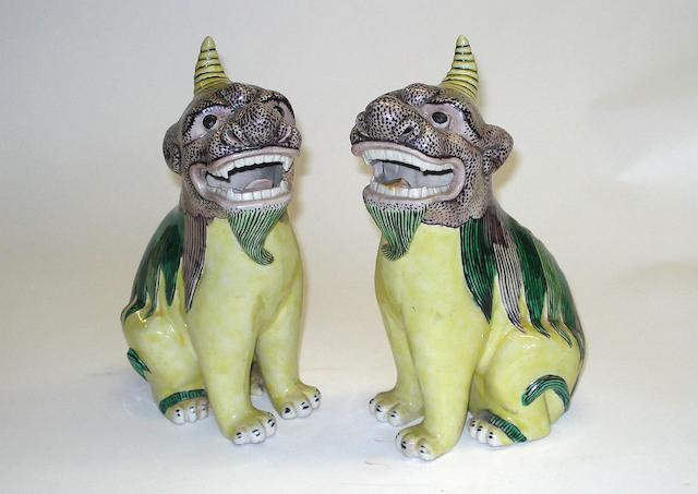 A pair of Chinese famille verte figures of lion dogs 19th/20th Century