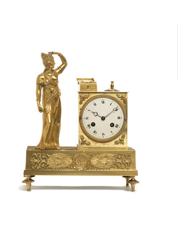 An early 19th century French ormolu figural mantal clock