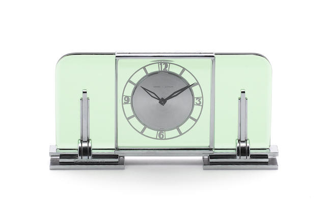 GARRARD: An Art Deco chrome and glass mantel clock, circa 1925,