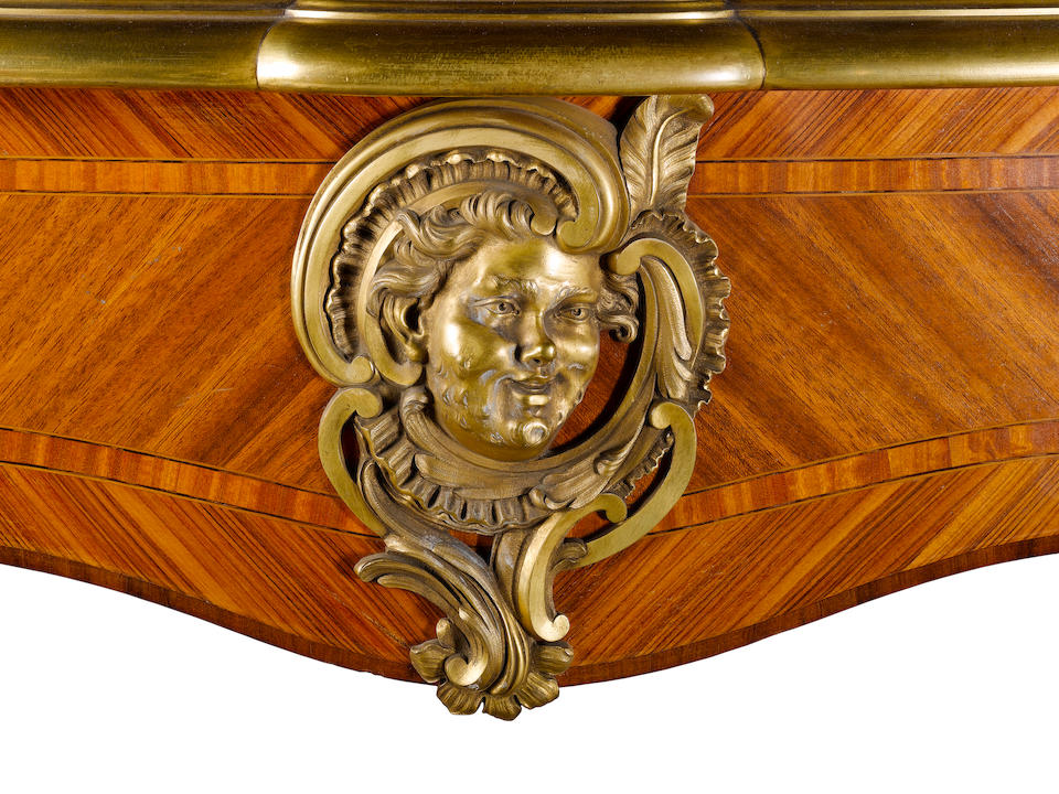 A French late 19th century ormolu mounted satiné kingwood and tulipwood bureau plat by Francois Linke, Paris, index number 972
