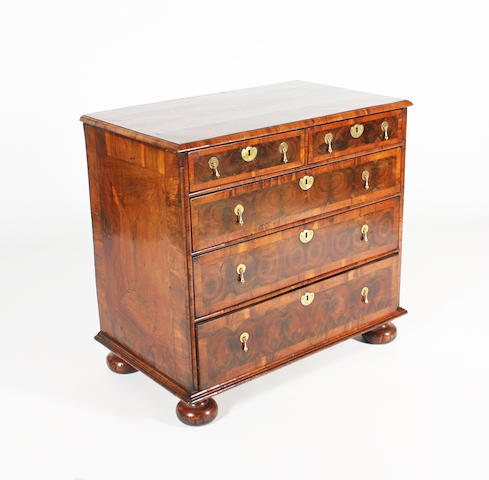 A good circa 1700 oyster veneered chest of drawers