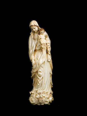A large 18th century Goan carved ivory group of the Virgin and Child