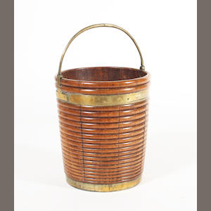 A George III Irish mahogany and brass bound peat bucket
