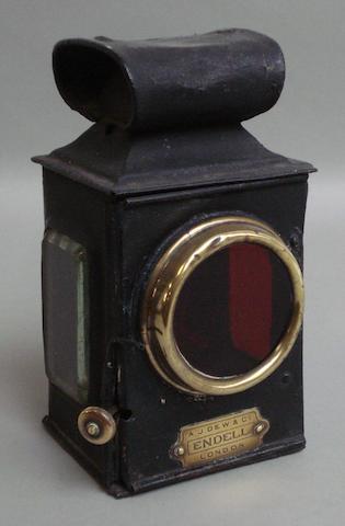A rear lamp by A.J Dew & Co,