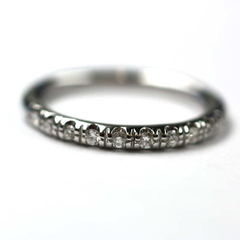 A diamond half eternity ring