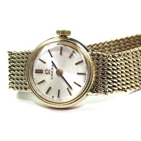 Omega: A lady's 9ct gold manual wind bracelet watch 1960s