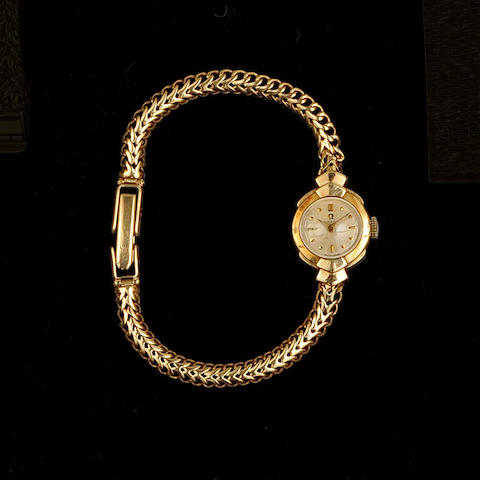 Omega: A lady's 18ct gold manual wind bracelet watch Retailed by Garrard and sold on 27th October 1956