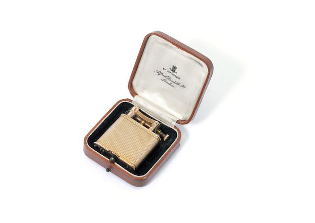 DUNHILL: A cased 9 carat gold 'Unique A' lighter, by Alfred Dunhill, London 1931,