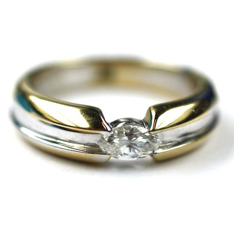 An 18ct yellow and white gold single stone diamond ring