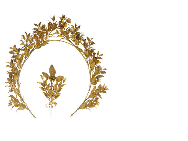 A gilt tiara and brooch suite, (2)