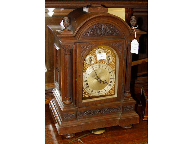A late Victorian carved oak architectural style bracket clock, the brass dial with silvered chapter ring, chime/silent, slow/fast, chime on 8 bells/chime on 4 gongs, subsidiary dials, with substantial 8 day movement, fluted pilasters, on a moulded plinth base, 55cm.