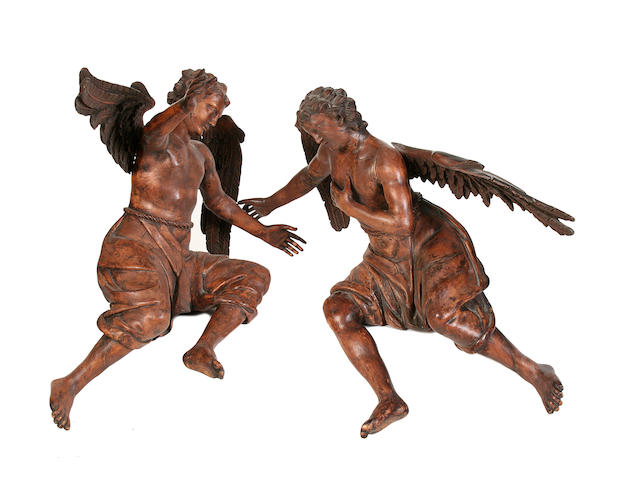 A pair of carved walnut figures of angels, 18th/19th Century