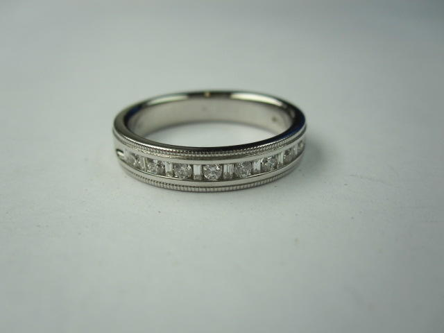 An 18ct white gold half eternity ring