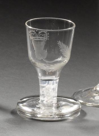 An engraved Jacobite opaque-twist firing glass