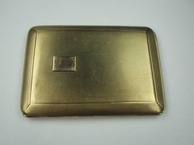 An 9ct cigarette case by Asprey