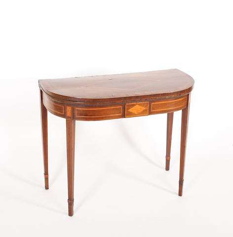 A George III mahogany, satinwood crossbanded, inlaid and line inlaid 'D' shaped card table