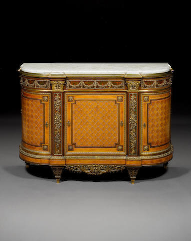 A French late 19th century Louis XVI style marquetry commode by Henry Dasson