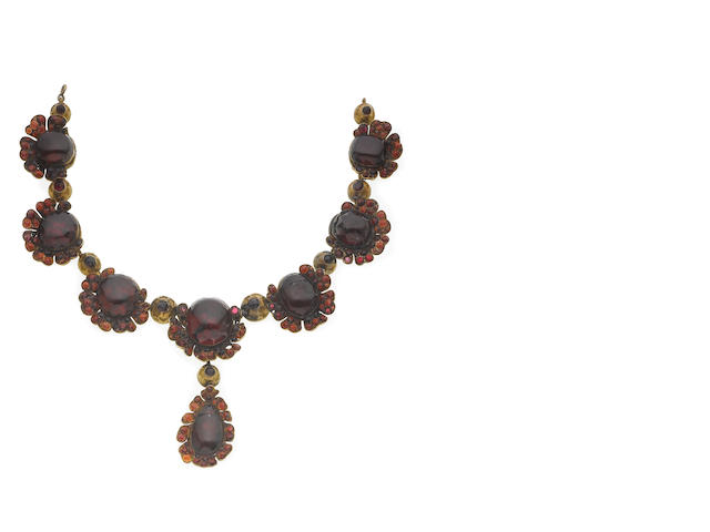 A garnet and silver gilt necklace,