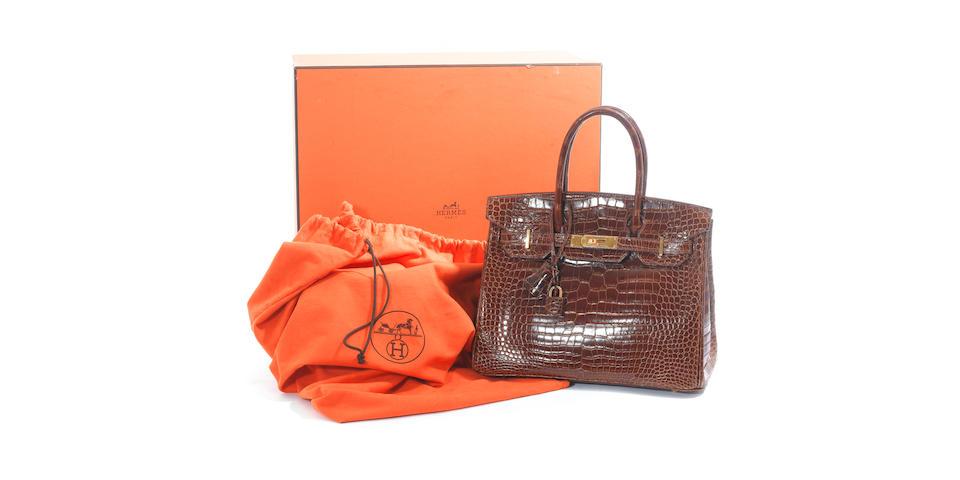 HERMÈS: An Hermès Miel crocodile Birkin bag