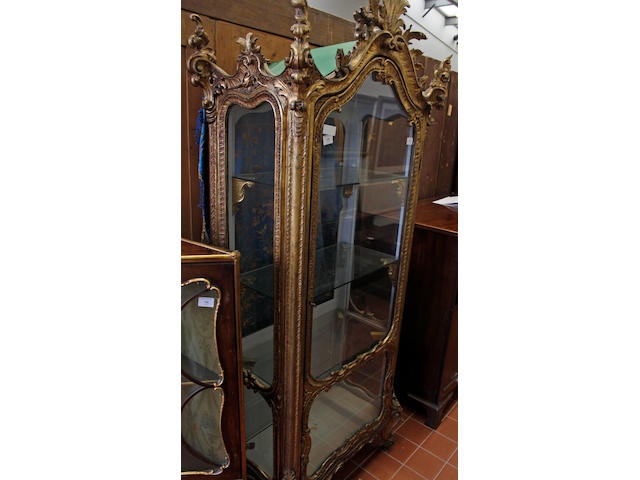A 19th Century rococco style carved and gilt wood vitrine,