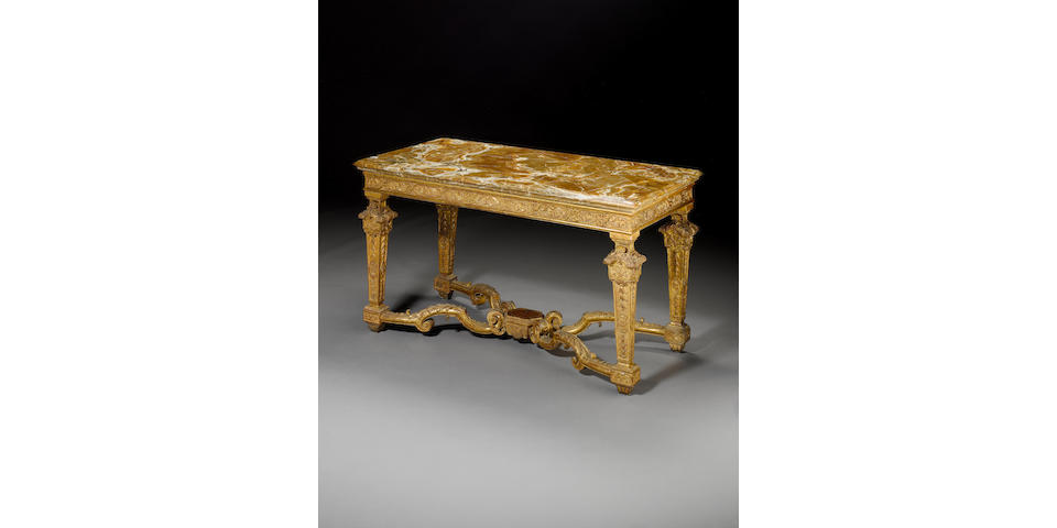 A Louis XIV giltwood console table with onyx top
