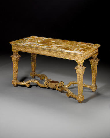 An impressive French 18th century Louis XIV giltwood console table with onyx top