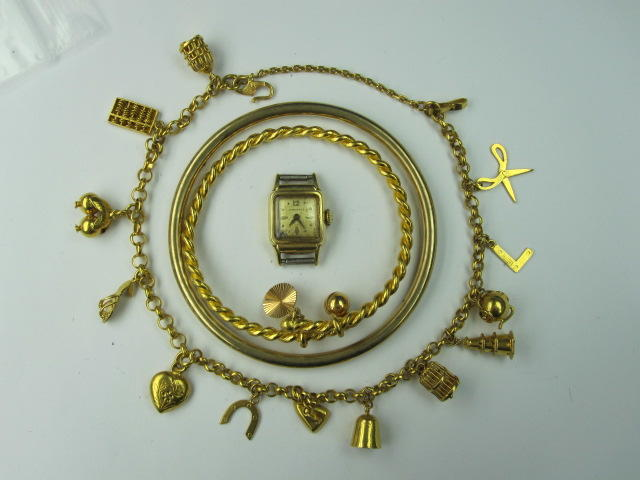 An Eastern yellow precious metal charm bracelet,